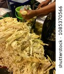 Small photo of Sugar cane is crush as a sweet drink. The sugarcane crushed on the side. Street food Thailand