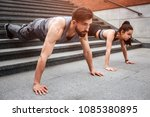 strong guy and well built girl... | Shutterstock . vector #1085380895