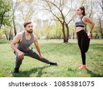 beautiful couple is stretching... | Shutterstock . vector #1085381075