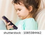cute little girl using modern... | Shutterstock . vector #1085384462