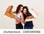 two young women and a hot pizza ... | Shutterstock . vector #1085385086