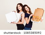 two young women and a hot pizza ... | Shutterstock . vector #1085385092