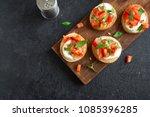 italian bruschetta with chopped ... | Shutterstock . vector #1085396285