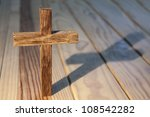 Cross On Wood Table Background