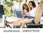 two female skaters best friends ... | Shutterstock . vector #1085475935