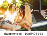 two female skaters best friends ... | Shutterstock . vector #1085475938