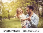 father and daughter at park... | Shutterstock . vector #1085522612