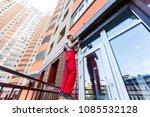 man installing roller shutter... | Shutterstock . vector #1085532128