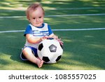 Smiling Boy With A Soccer Ball...