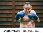 bad big fat boxer with blue... | Shutterstock . vector #1085560568