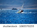 windsurfer riding red sea in...   Shutterstock . vector #1085570255