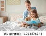 happy mother and her daughter... | Shutterstock . vector #1085576345