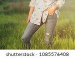 closeup of female jeans outdoor | Shutterstock . vector #1085576408