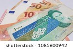 Small photo of Iran Riyal Euro Dollar