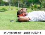 serene black man resting in...   Shutterstock . vector #1085705345