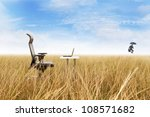 Outdoor office in a golden grass with success businessman jumping leaving his remote office - stock photo