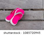 hot pink beach shoes laying on... | Shutterstock . vector #1085720945