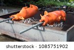 barbecued suckling pig bbq | Shutterstock . vector #1085751902