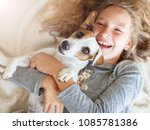 happy child with dog. portrait... | Shutterstock . vector #1085781386