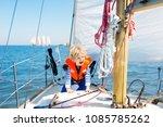 kids sail on yacht in sea.... | Shutterstock . vector #1085785262