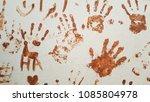 brown handprints on the wall.... | Shutterstock . vector #1085804978