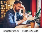 overwhelmed bearded young man... | Shutterstock . vector #1085823935