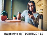 cheerful hipster blogger with... | Shutterstock . vector #1085827412