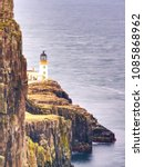 Small photo of Neist Point peninsula with lighthouse is a very photographed place and tourist attraction on Isle of Skye, Scotland. All travelers must see