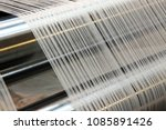 weaving loom at a textile... | Shutterstock . vector #1085891426