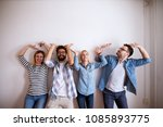 group of young smiling people... | Shutterstock . vector #1085893775