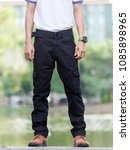 man wearing black cargo pants... | Shutterstock . vector #1085898965