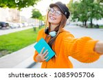 cheerful pretty brunette girl... | Shutterstock . vector #1085905706