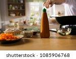 chefs hand reach to sauce... | Shutterstock . vector #1085906768