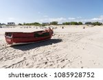 old wooden fishing boat at the... | Shutterstock . vector #1085928752