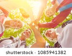 team high five in summer as... | Shutterstock . vector #1085941382