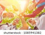 team high five in summer as... | Shutterstock . vector #1085941382