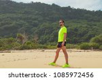 exercising on a tropical sandy... | Shutterstock . vector #1085972456