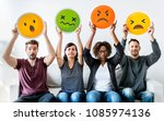 diverse people holding emoticon | Shutterstock . vector #1085974136
