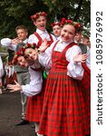 Small photo of RIGA, LATVIA - JULY 11, 2015: Young Dancers in traditional costumes behind scene waiting for time to perform at Grand Folk dance concert of Latvian Youth Song and Dance Festival in the Daugava Stadium