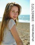 portrait of cute teenage girl... | Shutterstock . vector #1086017372