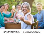in summer. a group of friends... | Shutterstock . vector #1086020522