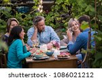 group of friends gathered... | Shutterstock . vector #1086021212