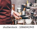man barista using coffee... | Shutterstock . vector #1086041945