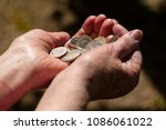 euro on hand. two hands of an... | Shutterstock . vector #1086061022