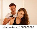physiotherapist doing tecar... | Shutterstock . vector #1086063602