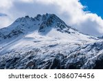 a snowy mountain peak along the ... | Shutterstock . vector #1086074456