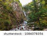 a gurgling stream heads down an ... | Shutterstock . vector #1086078356