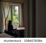 woman sitting on the chair near ... | Shutterstock . vector #1086078386