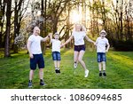 family jump in park. happy... | Shutterstock . vector #1086094685