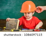little boy playing with hammer. ... | Shutterstock . vector #1086097115